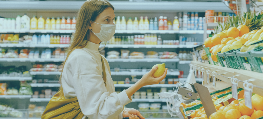 woman shopping at grocery store with mask